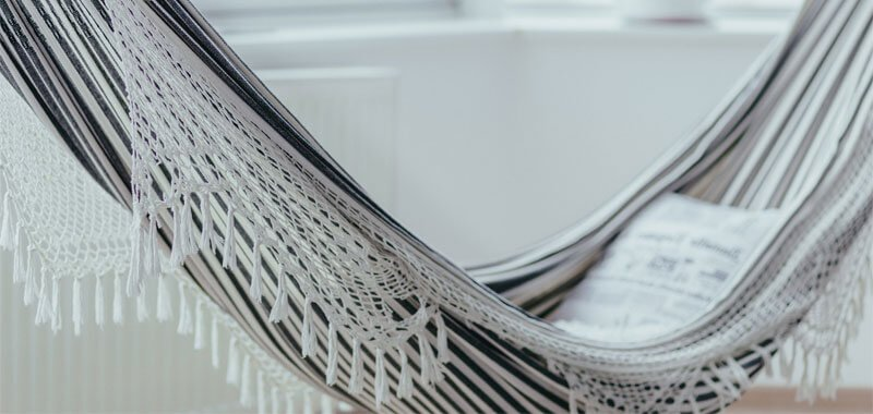 White and black hammock indoors