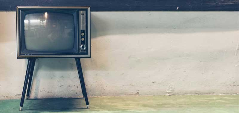 Old TV against wall