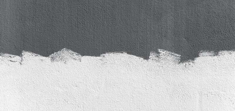 Concrete wall painted half gray half white