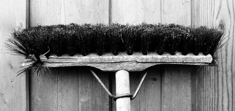 Broom head on wood floor